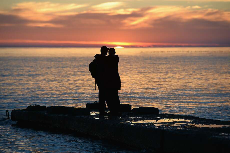 SOCHI, RUSSIA - FEBRUARY 13:  A couple looks at sunset on the black sea on day six of the Sochi 2014 Winter Olympics on February 13, 2014 in Adler, Russia.  (Photo by Pascal Le Segretain/Getty Images) Photo: Pascal Le Segretain, Getty Images