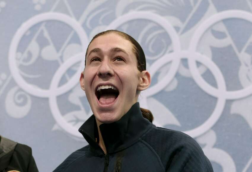 Jason Brown of the United States reacts in the results area after the men's short program figure skating competition at the Iceberg Skating Palace during the 2014 Winter Olympics, Thursday, Feb. 13, 2014, in Sochi, Russia. (AP Photo/Ivan Sekretarev)