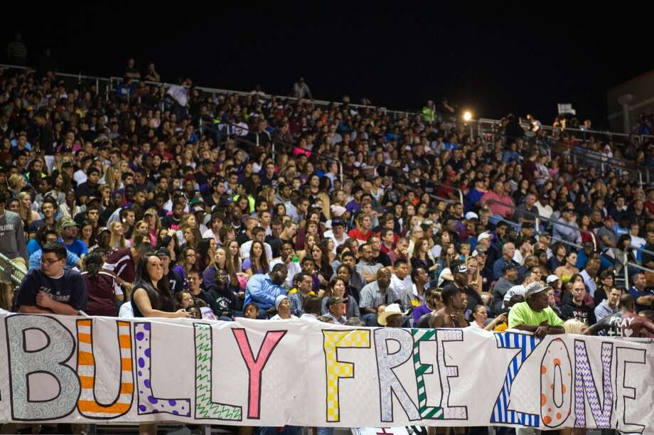 "A sign proclaims the stadium to be a ""Bully Free Zone"" during the second half of a high school football game between Manvel and Pearland at The Rig on Friday, Nov. 2, 2012, in Pearland. ( Smiley N. Pool / Houston Chronicle ) Photo: Houston Chronicle"