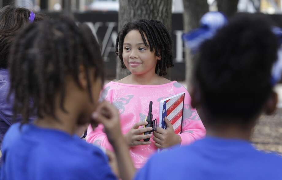 Victoria Baynes, 10,  speaks to participants during an anti-bullying rally at the Gerald D. Hines Waterwall Park,  2800 Post Oak Blvd., Wednesday, Jan. 23, 2013, in Houston. Youth volunteer Victoria Baynes and her mother Kim Baynes organized the rally that included a meet and greet with two Harlem Globetrotter players and donations for the Houston Food Bank. Victoria has volunteered and organized events with the help of her mother since she was 4-years-old.  ( Melissa Phillip / Houston Chronicle ) Photo: Houston Chronicle