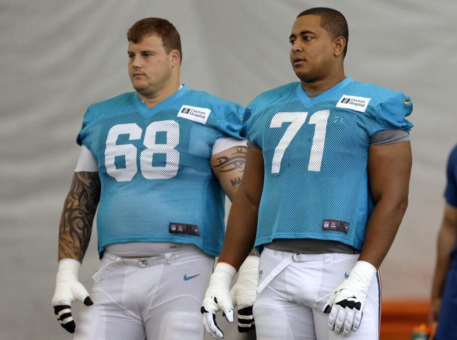 "FILE - In this July 24, 2013, file photo, Miami Dolphins guard Richie Incognito (68) and tackle Jonathan Martin (71) stand on the field during NFL football practice in Davie, Fla. Incognito has lashed out at Martin on Twitter, saying ""The truth is going to bury you and your entire 'camp.' You could have told the truth the entire time."" Incognito also wrote Martin told him he thought about committing suicide last May because he wasn't playing well. Incognito's series of tweets Wednesday, Feb. 12, 2014, directed at Martin and his representatives come as the NFL is preparing to release a report on the Dolphins' bullying case which could shed light on their relationship. (AP Photo/Lynne Sladky, File) Photo: Associated Press"