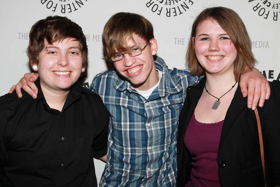 """Film subjects Kelby Johnson, left, and Alex Libby pose with activist Katy Butler, right, at a special screening of """"Bully"""" presented by The Weinstein Company and JP Morgan Chase and Company in partnership with Bing and Gucci, in New York on Tuesday, March 20, 2012. The film, directed by Sundance and Emmy-Award winning filmmaker Lee Hirsch, will be released in theaters on March 30. (AP Photo/StarPix, Dave Allocca) Photo: Associated Press"""