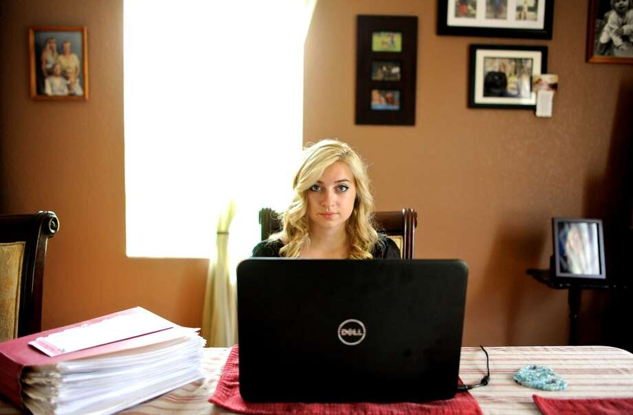 "Sarah Ball, a victim of cyber bullying during her high school years, sits for a portrait at her home on Wednesday, Oct. 23, 2013, in Spring Hill, Fla. Ball, now a student at a nearby community college, maintains a Facebook site called ""Hernando Unbreakable"", an anti-bullying page and mentors local kids identified by the schools as victims of cyberbullying. (AP Photo/Brian Blanco) Photo: Associated Press"