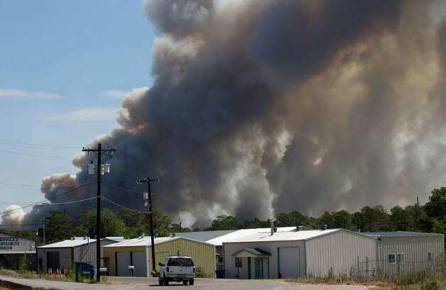 Fires burn near Bastrop, Texas Monday September 5, 2011. JOHN DAVENPORT/jdavenport@express-news.net Photo: JOHN DAVENPORT, SAN ANTONIO EXPRESS-NEWS / SAN ANTONIO EXPRESS-NEWS (Photo can be sold to the public)