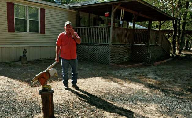 Alvin Becker, former U. S. Marine, wipes away tears after seeing the wooden eagle he carved still standing upon returning to their home in Circle D Estates after the wildfires near Bastrop, Texas, Monday September 12, 2011. Their home and three others next to it were the only one still standing Monday, thanks to the efforts of their neighbor Randy Stack who stayed behind and used garden hoses to keep the flames down all week. Officials are saying approximately 1,500 homes have been destroyed making this the worst wildfire disaster in Texas history.  (Erich Schlegel/Special Contributor) Photo: Erich Schlegel, Houston Chronicle / ©2011 Erich Schlegel