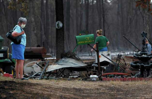 Ranch Crest resident Beverly Nichols, 72, is one of many residents to return to her home on Sunday, Sept. 11, 2011, in Magnolia.  Nichols has smoke damage inside her home and a destroyed shed where working tools where kept. Montgomery County officials say FM 1488 is open west to Woodland Lakes where there will be a checkpoint for residents to pass to the Ranch Crest subdivision. Photo: Mayra Beltran, Houston Chronicle / © 2011 Houston Chronicle