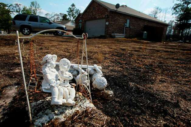 Decorative pieces survived the fire along with the home of resident Beverly Nichols, but surrounding property was heavily damaged in the Ranch Crest subdivision in Magnolia. Photo: Mayra Beltran, Houston Chronicle / © 2011 Houston Chronicle