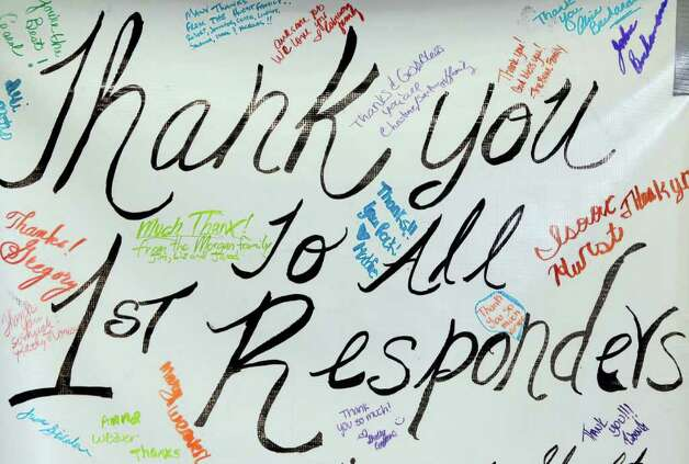 A thank you sign is seen posted at the wildfire command center at Magnolia West High School Sunday, Sept. 11, 2011, in Magnolia.   Thousands of people and animals have been forced off their property since the fires started Monday, spreading across parts of Montgomery, Waller and Grimes counties. Photo: Melissa Phillip, Houston Chronicle / © 2011 Houston Chronicle