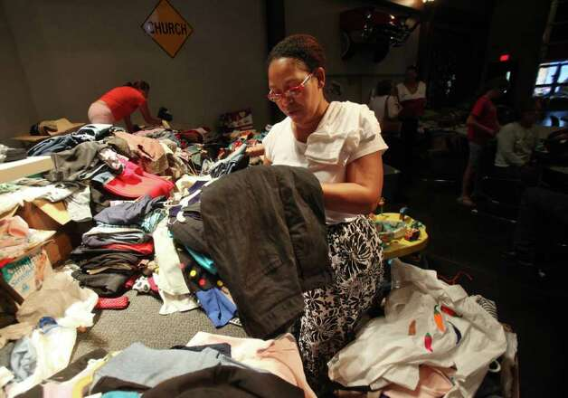 Patricia Cartwright sorts through donated clothes at the Red Cross Shelter located inside Wildwood United Methodist Church on Sunday, Sept. 11, 2011, in Magnolia. Cartwright evacuated from her Ranch Crest home, and does not know if her home not damaged. Photo: Mayra Beltran, Houston Chronicle / © 2011 Houston Chronicle