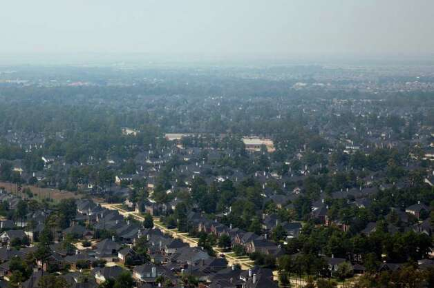 Smoke from wildfires to the north west of the city causes a haze over subdivisions in Houton suburb of Cypress on  Saturday, Sept. 10, 2011. Photo: Smiley N. Pool, Houston Chronicle / © 2011  Houston Chronicle