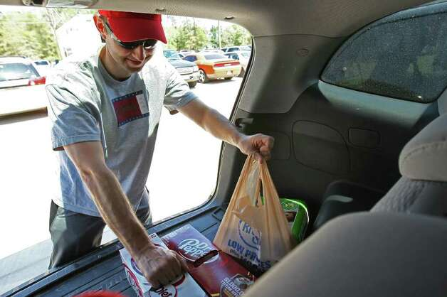 Joe Fisher of The Woodlands removes supplies to donate to evacuees of the recent wildfires  Saturday at Wildwood United Methodist Church in Magnolia. (Eric Christian Smith / For the Chronicle) Photo: Eric Christian Smith, For The Chronicle