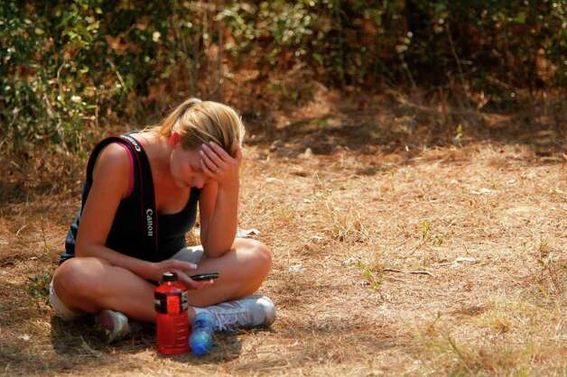 Angel Wagnon weeps after finding out her home is still standing, but that other Remington Subdivision homes are in bad shape on Wednesday, Sept. 7, 2011, in Todd Mission, Texas. Photo: Mayra Beltran, Houston Chronicle / © 2011 Houston Chronicle