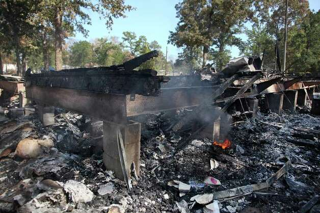 Fire consumed a home in the Ranch Crest subdivision near Magnolia. Photo: Mayra Beltran, Houston Chronicle / © 2011 Houston Chronicle