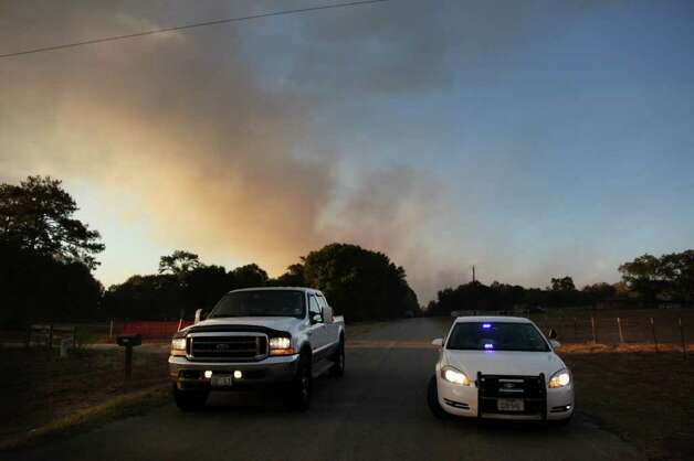 Residents drive south of Hegar Rd. Photo: Mayra Beltran, Houston Chronicle / © 2011 Houston Chronicle
