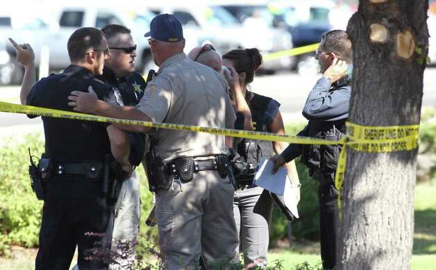 Emergency personnel respond to a shooting at an IHOP restaurant in Carson City, Nev. on Tuesday, Sept. 6, 2011. Seven people were wounded after a gunman opened fire at the restaurant, authorities said. (AP Photo/Cathleen Allison) Photo: Cathleen Allison, FRE / FR70203 AP