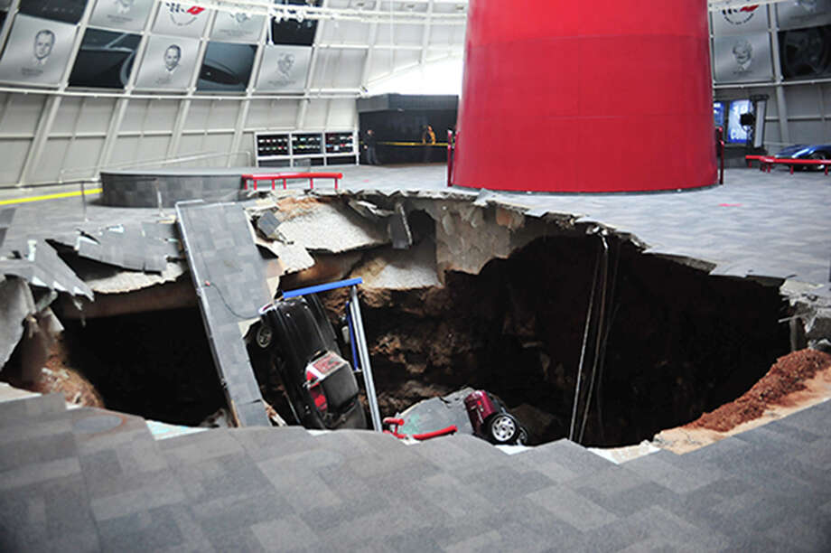 In this image provided by the National Corvette Museum shows several cars that collapsed into a sinkhole Wednesday, Feb. 12, 2014, in Bowling Green, Ky. The museum said a total of eight cars were damaged when a sinkhole opened up early Wednesday morning inside the museum. (AP Photo/National Corvette Museum, HO) Photo: AP / National Corvette Museum