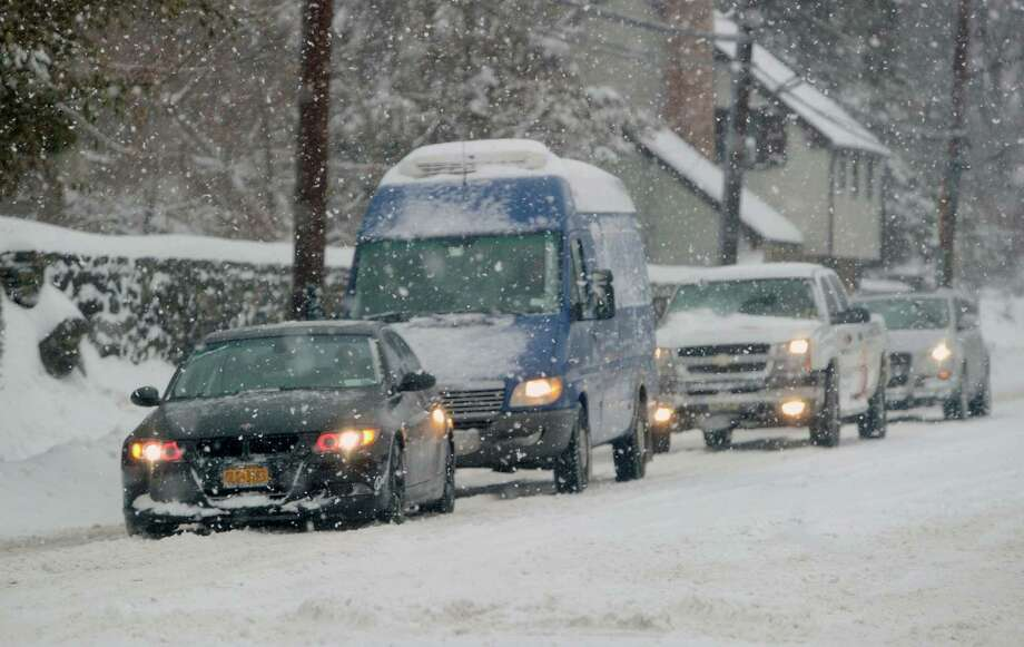 Traffic on West Putnam Avenue during the snowstorm that hit Greenwich, Conn., Thursday, Feb. 13, 2014. The National Weather Service is forecasting a total possible accumulation of 10 inches of snow by the time the storm ends Friday morning. Photo: Bob Luckey / Greenwich Time