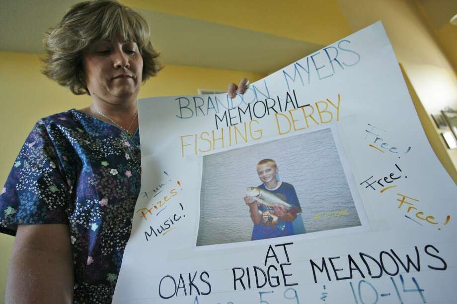 **APN ADVANCE FOR SUNDAY, JAN. 27** Kim Myers holds a poster used to promote a memorial fishing derby in honor of her son, Brandon, who killed himself in February of  2007, in Lee's Summit, Mo. For Kim Myers, Brandon's death is the result of what she calls incessant bullying that his teachers and other administrators at Voy Spears Elementary School failed to stop. (AP Photo/Ed Zurga) Photo: AP