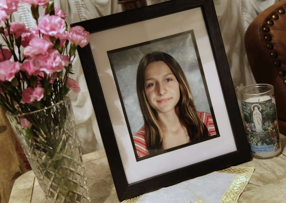 A portrait of Sladjana Vidovic, who committed suicide in 2008, sits in the livingroom of her family's Mentor, Ohio on Wednesday, Sept. 1, 2010.  Sladjana was one of five Mentor High School teenagers who died within two and a half years. Four committed suicide and the fifth died of what her parents say was an accidental prescription drug overdose. Friends and family say bullying drove most of them to kill themselves.(AP Photo/Amy Sancetta) Photo: AP
