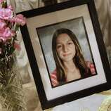A portrait of Sladjana Vidovic, who committed suicide in 2008, sits in the livingroom of her family's Mentor, Ohio on Wednesday, Sept. 1, 2010.  Sladjana was one of five Mentor High School teenagers who died within two and a half years. Four committed suicide and the fifth died of what her parents say was an accidental prescription drug overdose. Friends and family say bullying drove most of them to kill themselves.(AP Photo/Amy Sancetta)