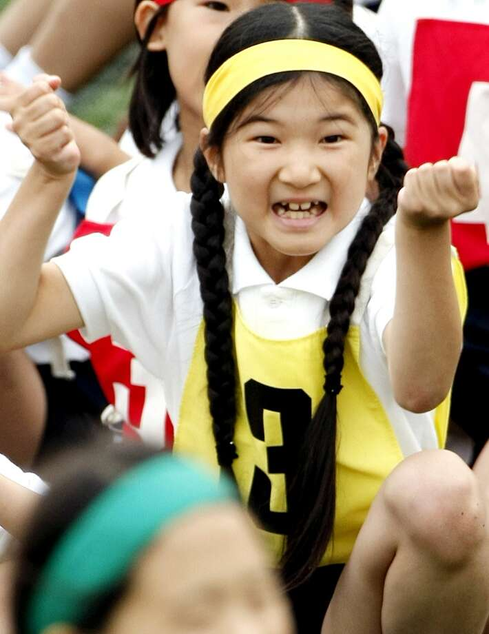 FILE - In this Oct. 17. 2009 file photo, Japan's Princess Aiko, daughter of Crown Prince Naruhito and Crown Princess Masako, celebrates over her relay team's victory in a race during the annual sports meet at Gakushuin Primary School in Tokyo, Japan. The eight-year-old princess has missed several days of class because of bullying by boys at her school, a spokesman for the royal family said Friday, March 5, 2010. (AP Photo/Shuji Kajiyama, File) Photo: AP