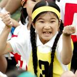 FILE - In this Oct. 17. 2009 file photo, Japan's Princess Aiko, daughter of Crown Prince Naruhito and Crown Princess Masako, celebrates over her relay team's victory in a race during the annual sports meet at Gakushuin Primary School in Tokyo, Japan. The eight-year-old princess has missed several days of class because of bullying by boys at her school, a spokesman for the royal family said Friday, March 5, 2010. (AP Photo/Shuji Kajiyama, File)