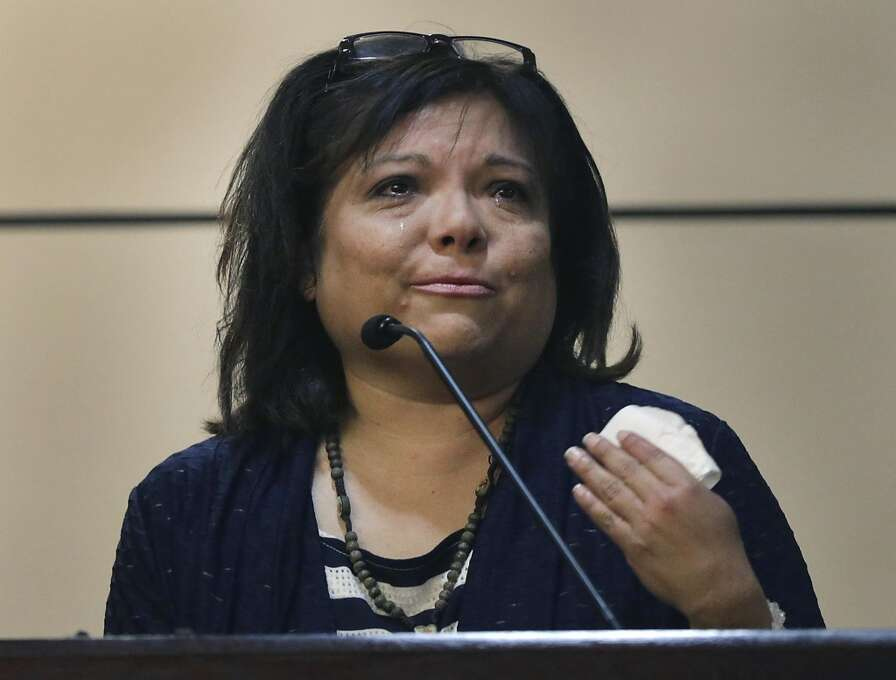 Former kindergarten teacher Cynthia Ambrose cries as she takes the witness stand in her own defense Thursday, June 20, 2013 in San Antonio. Ambrose, former San Antonio teacher accused of directing students to hit a schoolmate for being a bully has been convicted of official oppression. (AP Photo/San Antonio Express-News, Bob Owen) RUMBO DE SAN ANTONIO OUT; MAGS OUT; NO SALES; TV OUT; MANDATORY CREDIT Photo: Associated Press