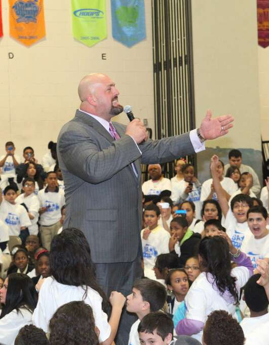 In this image released by World Wrestling Entertainment, WWE personality Big Show speaks to students from grades 5-8  during an anti-bullying rally at Luis Munoz Marin School, Thursday, March 15, 2012 in Bridgeport, Conn. (AP Photo/WWE) Photo: Associated Press