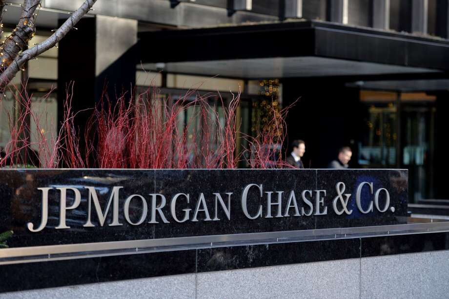 Financial giant JP Morgan Chase & Co. announced it would cut about 8,000 jobs in consumer and community banking this year, but it would add about 3,000 jobs in other areas. Photo: STAN HONDA, AFP/Getty Images