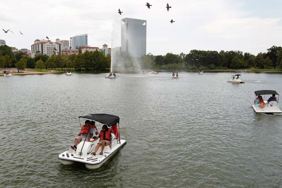 McGovern Lake in Hermann Park6201 Hermann Park Dr, Houston Bank and pier access, plus paddleboats, although you can't fish from the boats. Photo: Houston Chronicle