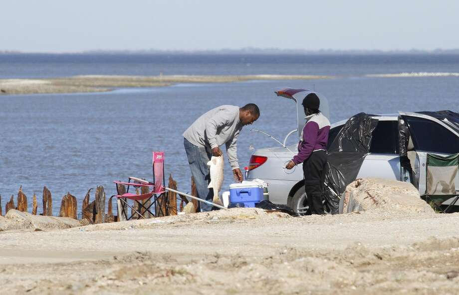 Rollover PassI-45 south to Galveston, left on Seawall, left on Ferry Road, take ferry to Bolivar, go about 20 miles to reach Rollover Pass. Fishing in Galveston Bay. Note: Rollover Pass is slated for closure by the Texas General Land Office.  Photo: Houston Chronicle