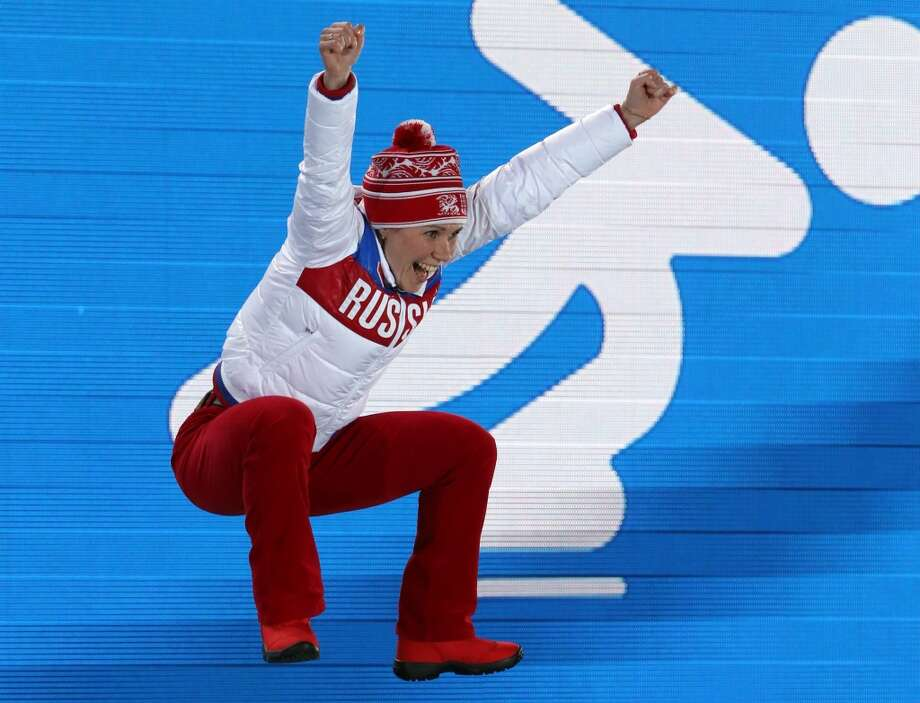 Russia's bronze medalist Olga Graf celebrates on the podium after the Women's Speed Skating 3000 m Medal Ceremony at the Sochi medals plaza during the Sochi Winter Olympics on February 10, 2014. Photo: AFP, AFP/Getty Images