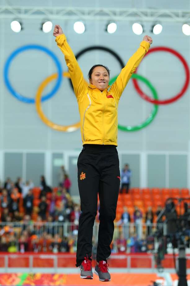 Gold medalist Hong Zhang of China celebrates on the podium during the flower ceremony for the Speed Skating Women's 1000m event on day 6 of the Sochi 2014 Winter Olympics at Adler Arena Skating Center on February 13, 2014 in Sochi, Russia. Photo: Quinn Rooney, Getty Images