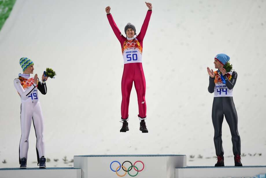 Silver medalist Slovenia's Peter Prevc, Gold medalist Poland's Kamil Stoch and Bronze medalist Norway's Anders Bardal  celebrate during the Men's Ski Jumping Normal Hill Individual. Photo: JOHN MACDOUGALL, AFP/Getty Images
