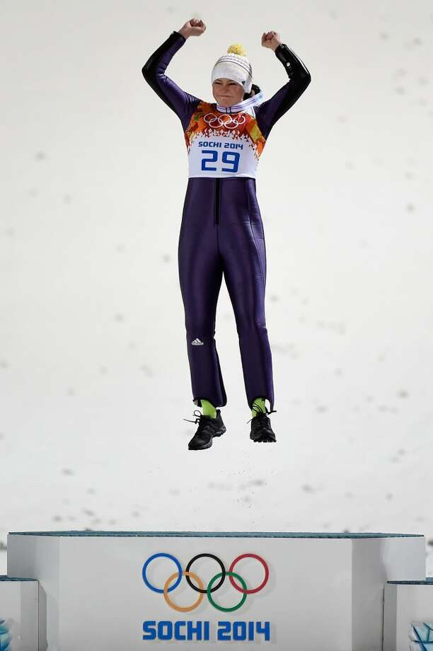 Gold medalist Carina Vogt of Germany celebrates on the podium during the flower ceremony for the Ski Jumping Ladies Normal Hill Individual. Photo: Lars Baron, Getty Images