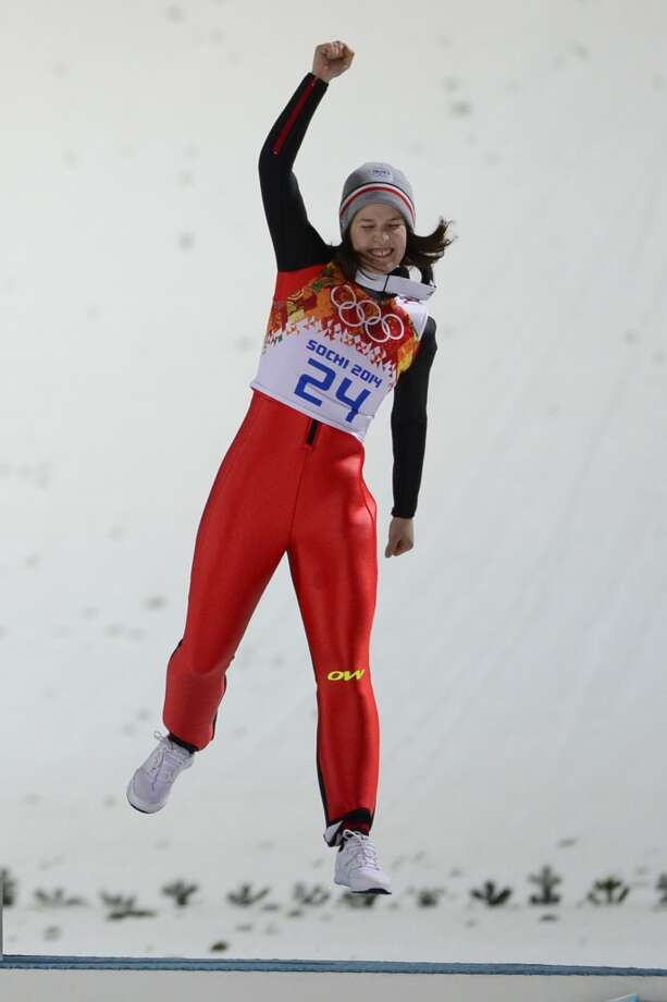France's Coline Mattel celebrates winning bronze in the Women's Ski Jumping Normal Hill Individual Flower Ceremony. Photo: JOHN MACDOUGALL, AFP/Getty Images
