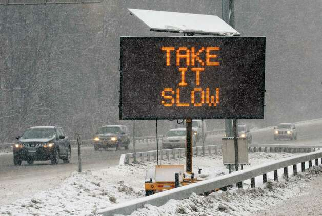 A sign on I-87 advises motorists to use caution while navigating snowy conditions Thursday, Feb. 13, 2014, in Colonie, N.Y. (Michael P. Farrell/Times Union) Photo: Michael P. Farrell / 00025747A