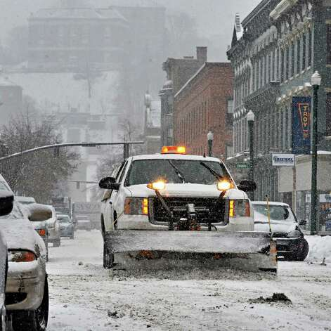 A Troy City truck clears snow along Broadway Thursday Feb. 13, 2014, in Troy, NY.   (John Carl D'Annibale / Times Union) Photo: John Carl D'Annibale / 00025747A