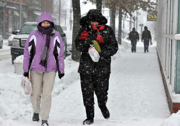 Maria Williams, left, of Clifton Park, and Pam Rochminski of Colonie walk back to work along 3rd St. after shopping for Valentine's Day cards Thursday Feb. 13, 2014, in Troy, NY.   (John Carl D'Annibale / Times Union) Photo: John Carl D'Annibale / 00025747A