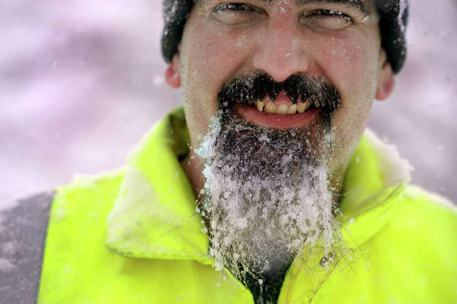 Joe Moffa, 42, has a beard full after icy-snow from snowblowing his walkway on Cleveland Street in Danbury, Conn., Thursday, February 13, 2014. Photo: Carol Kaliff / The News-Times