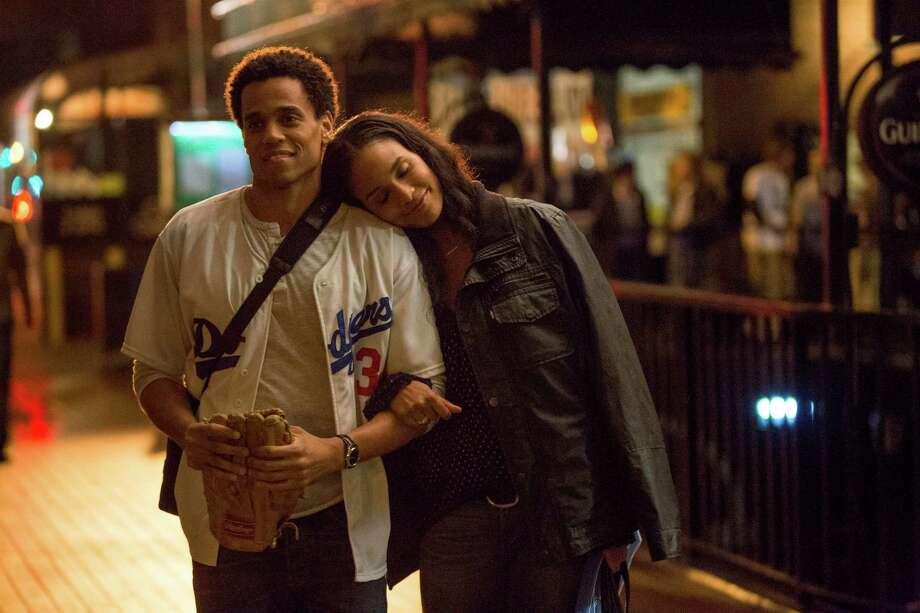 "This image released by Sony Pictures shows Michael Ealy, left, and Joy Bryant in a scene from ""About Last Night."" (AP Photo/Sony Pictures, Matt Kennedy) ORG XMIT: NYET151 Photo: Matt Kennedy / Sony Pictures"