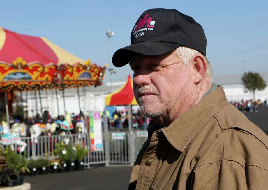 "Red Cox discusses the impact the cold weather has had on revenues at the carnival at the The San Antonio Stock Show & Rodeo. The event leans heavily on its ""dollar days"" – the three Fridays and Monday, Presidents Day, when admission to the rodeo grounds is $1 and so are food items and carnival rides – for revenue that it makes through admission. But frigid weather Feb. 7 kept attendance down, and instead of observing the holiday Monday, Feb. 17, most local students will be in class to make up for a January snow day. Photo: Helen L. Montoya, San Antonio Express-News / ©2013 San Antonio Express-News"