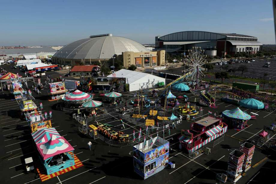 "View of the carnival from the Big Wheel before the carnival opens at 4 pm. The San Antonio Stock Show & Rodeo leans heavily on its ""dollar days"" — the three Fridays and Monday, Presidents Day, when admission to the rodeo grounds is $1 and so are food items and carnival rides — for revenue that it makes through admission. But frigid weather Feb. 7 kept attendance down, and instead of observing the holiday Monday, Feb. 17, most local students will be in class to make up for a January snow day. Photo: Helen L. Montoya, San Antonio Express-News / ©2013 San Antonio Express-News"