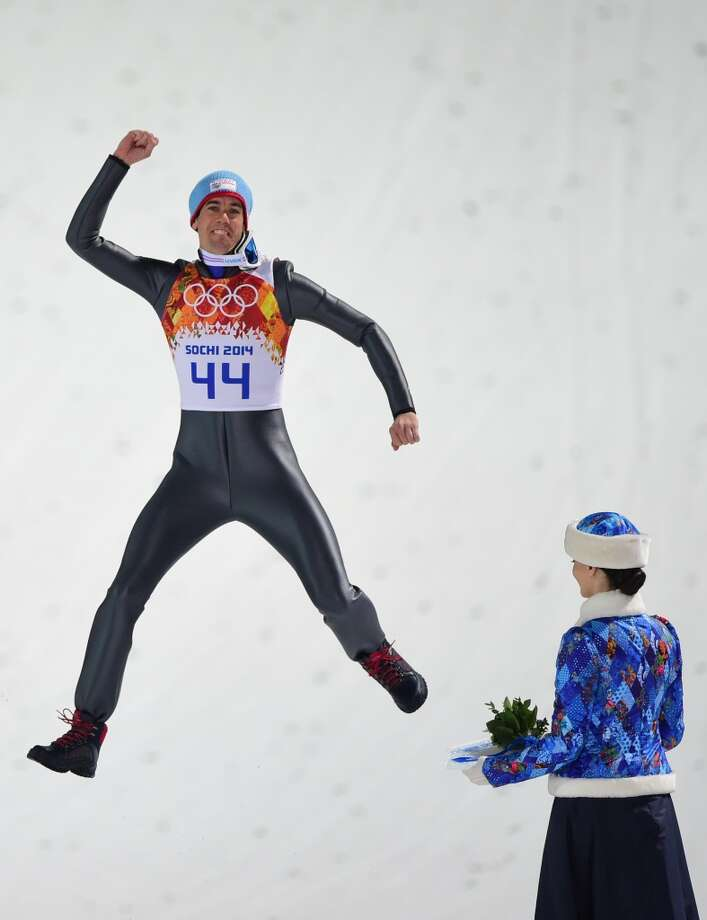 Bronze winner Norway's Anders Bardal reacts on the podium during the Men's Ski Jumping Normal Hill Individual Flower Ceremony at the RusSki Gorki Jumping Center during the Sochi Winter Olympics on February 9, 2014 in Rosa Khutor. Photo: JOHN MACDOUGALL, AFP/Getty Images