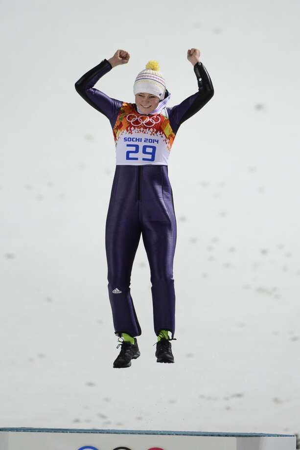 Germany's Carina Vogt celebrates winning gold in the Women's Ski Jumping Normal Hill Individual Flower Ceremony at the RusSki Gorki Jumping Center during the Sochi Winter Olympics on February 11, 2014 in Rosa Khutor near Sochi. Photo: JOHN MACDOUGALL, AFP/Getty Images