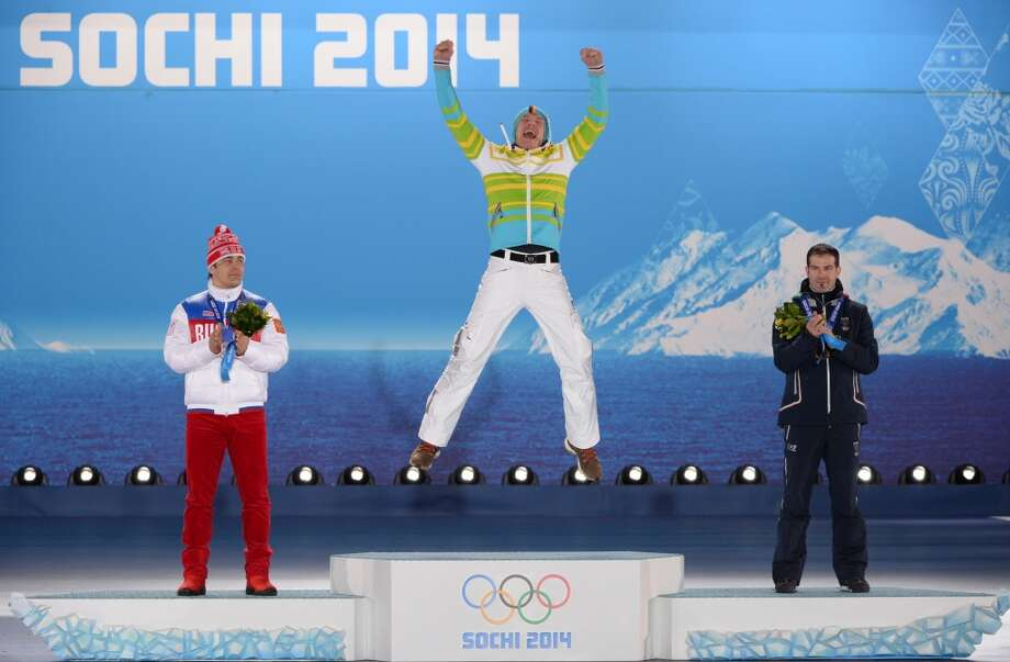 Russia's silver medalist Albert Demchenko, Germany's gold medalist Felix Loch and Italy's bronze medalist Armin Zoeggeler celebrating on the podium during the Men's Luge Singles. Photo: ANTONIN THUILLIER, AFP/Getty Images