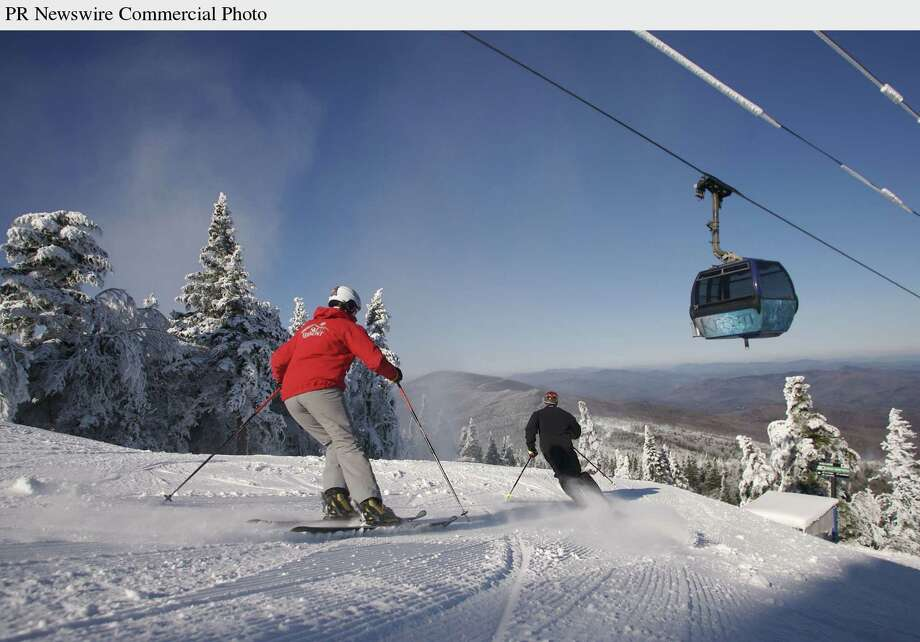 Skiers enjoy early turns off the top of Killington Peak, the highest lift- served terrain in Vermont on Tuesday, Nov. 21. Killington Resort opens for the season on Thursday with 16 trails served by seven lifts.  (PRNewsFoto/Killington Resort,Justin Cash) Photo: JUSTIN CASH/KILLINGTON / KILLINGTON RESORT