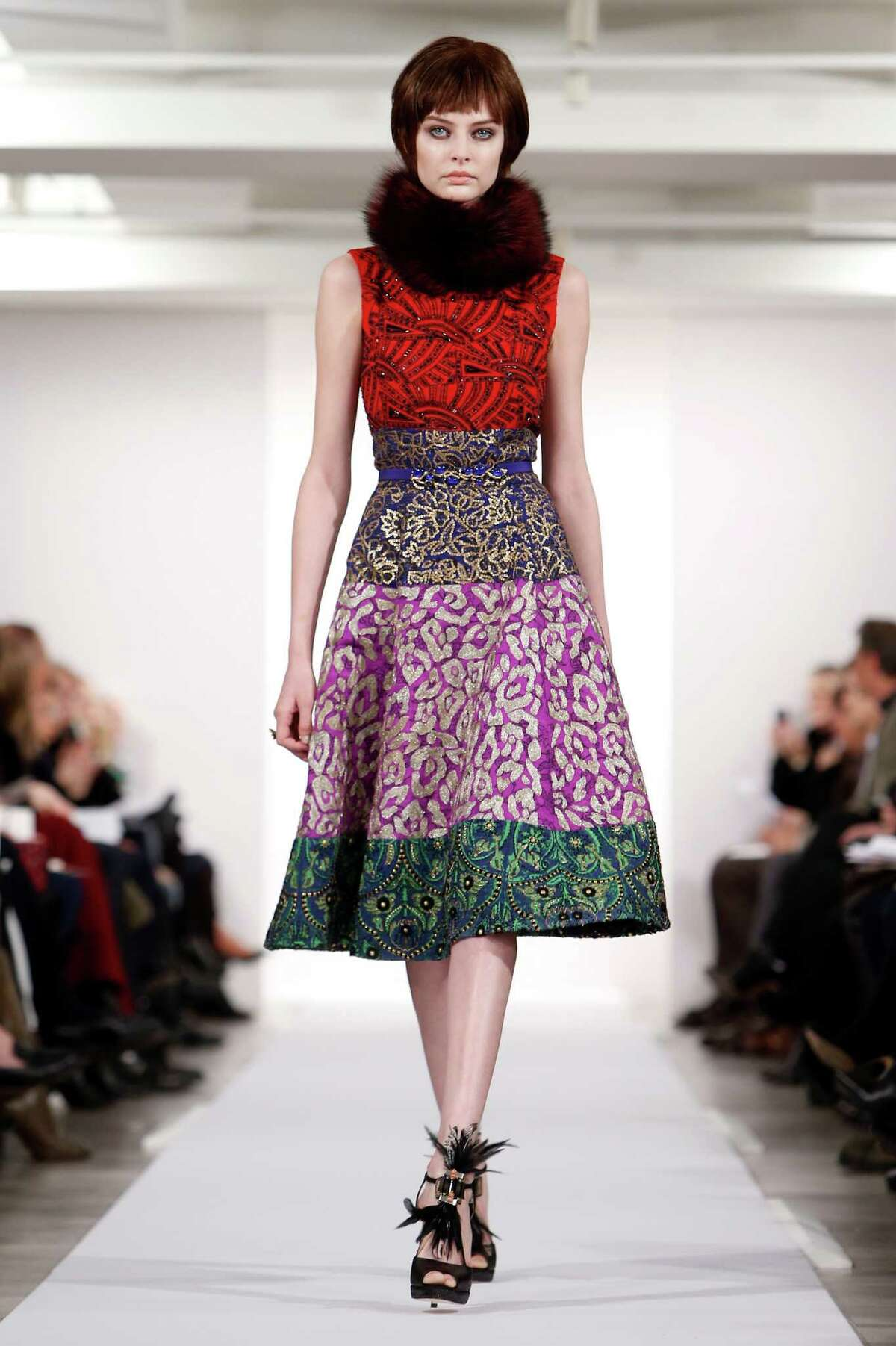 The Oscar de la Renta Fall 2014 collection is modeled during Fashion Week in New York, Tuesday, Feb. 11, 2014. (AP Photo/Jason DeCrow)