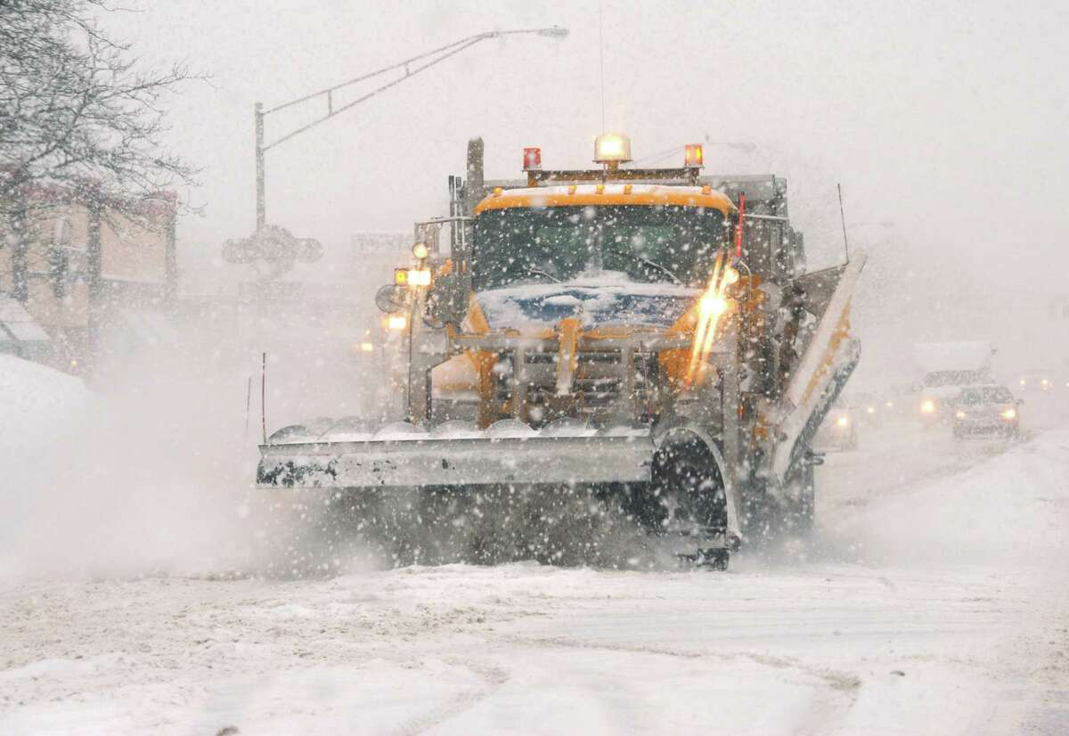 A plow makes a pass up Wolf Road on Thursday Feb. 13, 2014 in Colonie, N.Y. (Michael P. Farrell/Times Union)