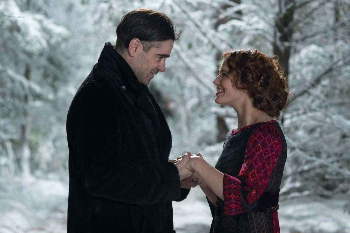 """Caption: (L-r) COLIN FARRELL as Peter Lake and JESSICA BROWN FINDLAY as Beverly Penn in Warner Bros. Pictures' and Village Roadshow Pictures' romantic fantasy adventure """"WINTER'S TALE, """" distributed worldwide by Warner Bros. Pictures and in select territories by Village Roadshow Pictures."""